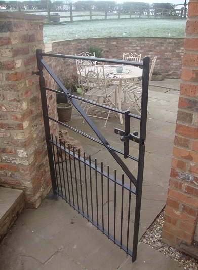 gate with strap hinge and bottom pivot